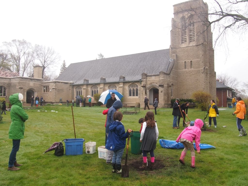 Families planting a community orchard in a churchyard in Ontario | Community orchard